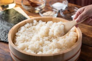 jaoanese sushi rice in wooden bowl with ingredients